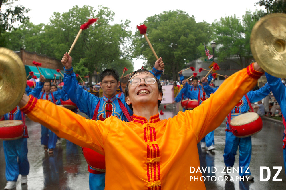 Tribune photo by David Zentz on July 3, 2005.Tony Liu leads Falun Gong drummers as pouring rain falls on the Evanston Fourth of July parade on Central Avenue in Evanston.