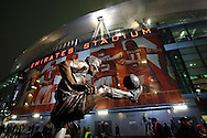 The Dennis Bergkamp statue outside the stadium before the UEFA Champions League match between Arsenal and Borussia Dortmund at the Emirates Stadium, London<br /> Picture by Richard Calver/Focus Images Ltd +447792 981244<br /> 26/11/2014