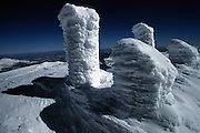 Rime ice covers every surface of Mt. Washington's summit, the highest point in New England. This New Hampshire high point long held the record for the highest wind gust directly measured at the Earth's surface, 231 mph (372 km/h) on the afternoon of April 12, 1934.