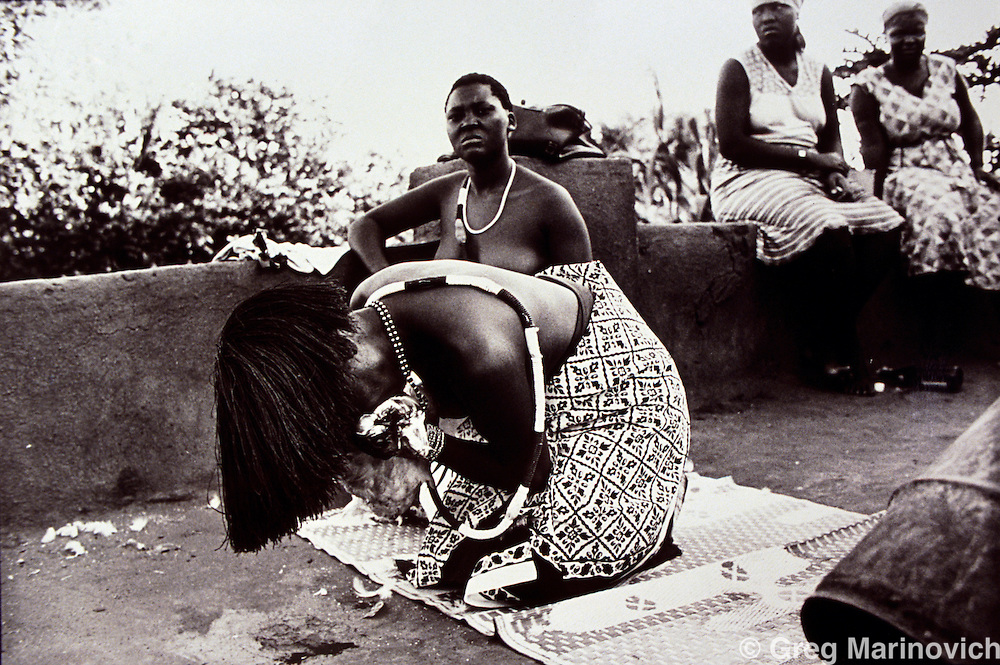 Dolly village, Gazankulu, South Africa. 1992/3. A woman undergoes an intiation into a VaNdau or foreign spirit possession cult. She has to kill a chicken. She went on to become a spirit medium in Soweto.