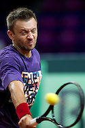 Michal Przysiezny of Poland while traning session two days before the BNP Paribas Davis Cup 2013 between Poland and Australia at Torwar Hall in Warsaw on September 11, 2013.<br /> <br /> Poland, Warsaw, September 11, 2013<br /> <br /> Picture also available in RAW (NEF) or TIFF format on special request.<br /> <br /> For editorial use only. Any commercial or promotional use requires permission.<br /> <br /> Photo by © Adam Nurkiewicz / Mediasport