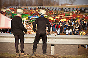 Young Amish boys watch the Annual Mud Sale to support the Fire Department  in Gordonville, PA.