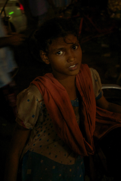 Little girl begging in the street of Old Delhi