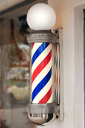 barber pole at the front of a barber shop