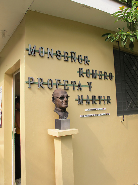 A bust of the martyr Archbishop Oscar Romero stands outside the priests residence across from the church where he was assassinated. The Archbishop was slain at the alter of his Church of the Divine Providence by a right wing gunman in 1980. Óscar Arnulfo Romero y Galdámez was a bishop of the Catholic Church in El Salvador. He became the fourth Archbishop of San Salvador, succeeding Luis Chávez, and spoke out against poverty, social injustice, assassinations and torture. Romero was assassinated while offering Mass on March 24,1980. - To license this image, click on the shopping cart below -