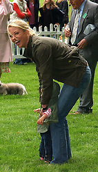 Rdio presenter SARA COX and her daughter LOLA at the 3rd annual Macmillan Dog Day in aid of Macmillan Cancer Relief held at Royal Hospital Chelsea, London SW3 on 5th July 2005.<br /><br />NON EXCLUSIVE - WORLD RIGHTS