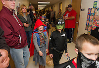 Little Red Riding Hood and the Swat Team are among the many creative costumes marching through the halls of Pleasant Street School on Friday afternoon for their Halloween Parade.  (Karen Bobotas/for the Laconia Daily Sun)