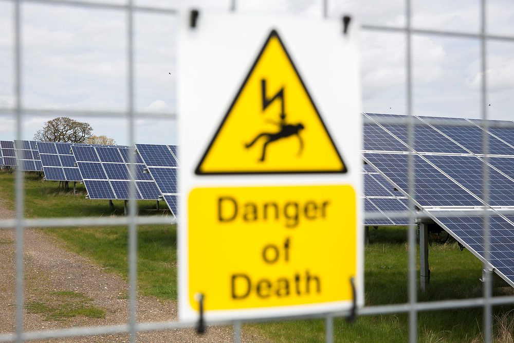 Danger of Death warning signs on the external fence of Salhouse Solar Park has an electrical output of 4.987 MW saving emissions of 4890 tonnes of C02 per year. Norfolk. UK.(photo by Andrew Aitchison / In pictures via Getty Images)