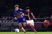 Northampton Town midfielder (on loan from Legia Warsaw) Hildeberto Pereira (28) battles with Shrewsbury Town midfielder Jon Nolan (20) during the EFL Sky Bet League 1 match between Northampton Town and Shrewsbury Town at Sixfields Stadium, Northampton, England on 20 March 2018. Picture by Dennis Goodwin.