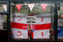A general view of a tribute to Gordon Banks in a bus window as it passes by the bet365 Stadium, Stoke.