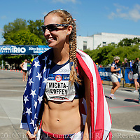 Maria Michta-Coffey smiles while being wrapped in an American Flag after winning the womens Olympic Trials 20K race walk in 1:33.42, in Salem, Ore., on Thursday  June 30, 2016.