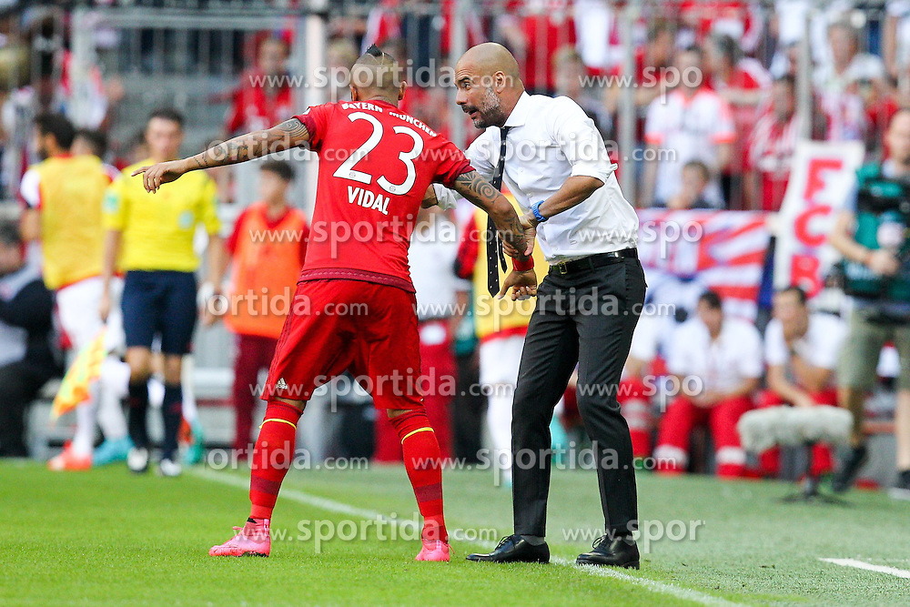 12.09.2015, Allianz Arena, Muenchen, GER, 1. FBL, FC Bayern Muenchen vs FC Augsburg, 4. Runde, im Bild l-r: Arturo Vidal #23 (FC Bayern Muenchen) bekommt von Chef-Trainer Pep Guardiola (FC Bayern Muenchen) anweisungen // during the German Bundesliga 4th round match between FC Bayern Munich and FC Augsburg at the Allianz Arena in Muenchen, Germany on 2015/09/12. EXPA Pictures &copy; 2015, PhotoCredit: EXPA/ Eibner-Pressefoto/ Kolbert<br /> <br /> *****ATTENTION - OUT of GER*****