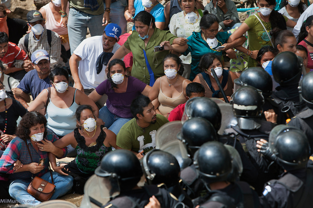 Police officers storm the La Puya camp and are only meters away from the locals who are blocking the entrance to the El Tambor mine. After two years and two months of peacefully blocking the entrance to U.S.-based Kappes, Cassiday & Associates (KCA) El Tambor gold mine, local residents of San Jose del Golfo and San Pedro Ayampuc were violently evicted by Guatemalan Police forces in order to introduce heavy machinery inside the industrial site. La Puya, San Pedro Ayampuc, Guatemala. May 23, 2014.