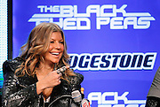 Female vocalist for The Black Eyed Peas, Stacy Ann Ferguson, better known as Fergie, points as she speaks to the media at the Super Bowl XLV Halftime Show press conference featuring The Black Eyed Peas (held during the week of NFL Super Bowl XLV between the Pittsburgh Steelers and the Green Bay Packers) on Thursday, February 3, 2011 in Dallas, Texas. ©Paul Anthony Spinelli
