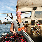Lobsterwoman Melanie Kratovil fishes off the coast of Biddeford, Maine in August 2011.