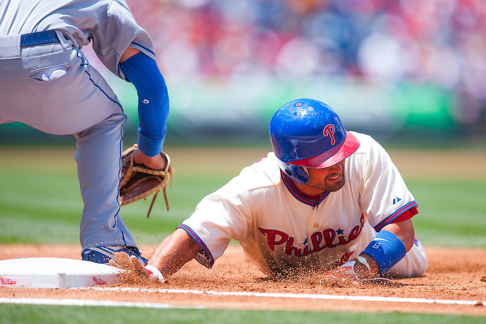 PHILADELPHIA, PA - JUNE 07: Shane Victorino #8 of the Philadelphia Phillies slides back into first base during the game against the Los Angeles Dodgers at Citizens Bank Park on June 7, 2012 in Philadelphia, Pennsylvania. (Photo by Rob Tringali) *** Local Caption *** Shane Victorino