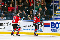 KELOWNA, BC - OCTOBER 16:  Kyle Topping #24 and Nolan Foote #29 of the Kelowna Rockets celebrate a second period goal against the Swift Current Broncos at Prospera Place on October 16, 2019 in Kelowna, Canada. (Photo by Marissa Baecker/Shoot the Breeze)