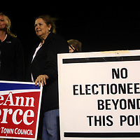 Candidate LeAnn Pierce stands with supporters outside of the Carolina Beach Recreation Center. (Jason A. Frizzelle)