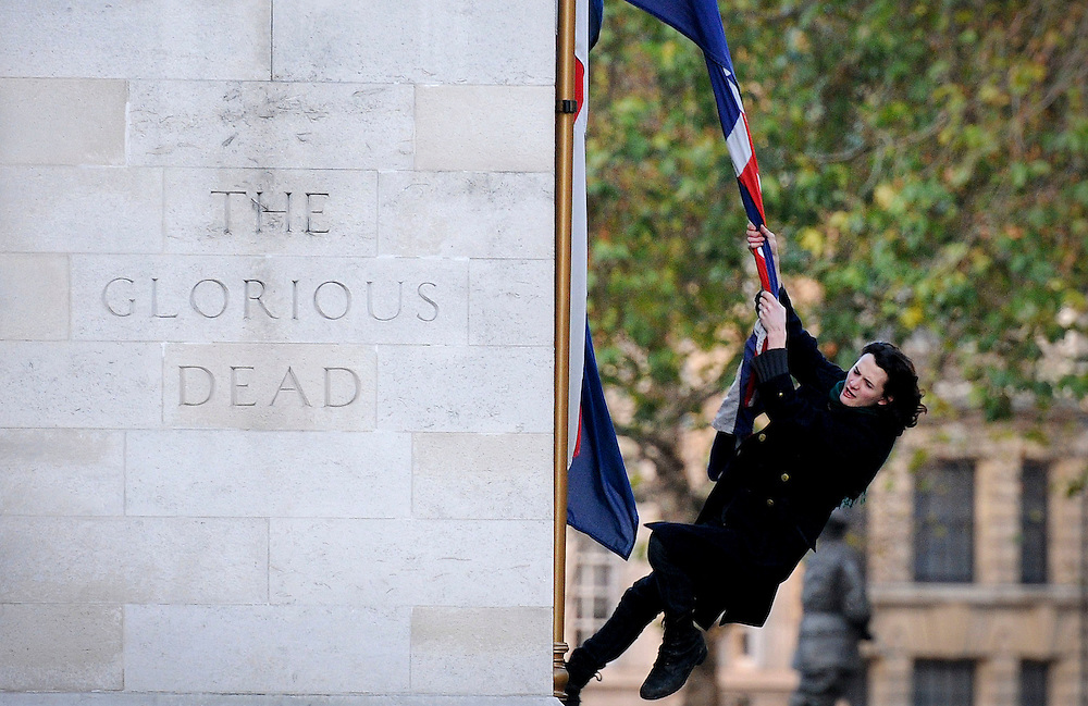 Charlie Gilmour Swings from a union jack flag on the side of the sacred Cenotaph on the 9th december 2010...As a result of this picture and an apology from Sir David Gilmour of the famous band Pink Floyd followed the next day after this photo making 7 papers...Today 25th March 2011 Charlie Gilmour, the son of Pink Floyd guitarist David Gilmour, is to appear at Westminster Magistrates  charged with violent disorder...Photographs by Ki Price 07940447610..