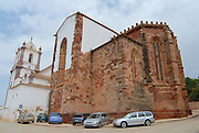SILVES, PORTUGAL - JULY 18, 2006: Cars parked outside of the Silves Cathedral in Silves, Portugal. Cathedral initially built as a mosque is considered the main Gothic monument in Algarve, Portugal.