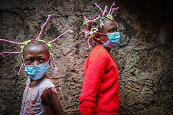 May 9, 2020: Nairobi, Kenya: 12 year old Martha Apisa (left) and her close neighbor 8 year old Stacy Ayuma (Right), are seen using their hair style braids to create awareness and sensation about the Corona Virus. (Credit Image: © Donwilson Odhiambo/ZUMA Wire)