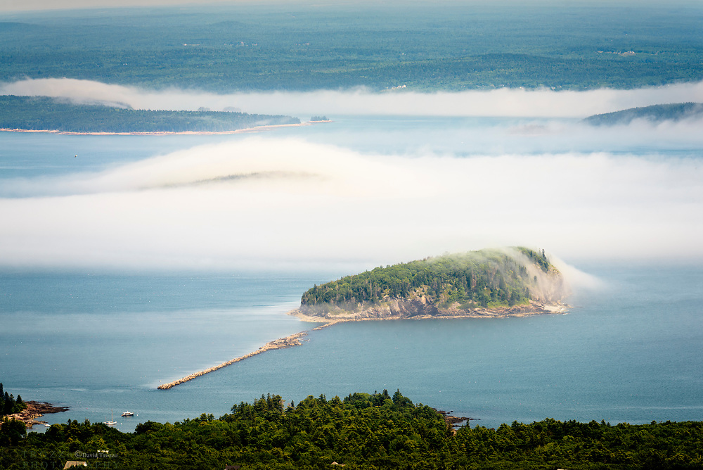 view from Cadillac Mountain, Acadia National Park, Bar harbor Maine. Fog ocean clouds island islands harbor thick vapor trails myst mystery mystic coastal coast aerial unique weather formation forming