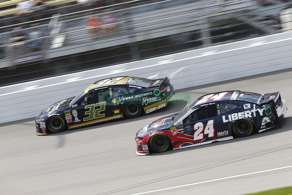 August 12, 2018 - Brooklyn, Michigan, United States of America - Matt DiBenedetto (32) and William Byron (24) battle for position during the Consumers Energy 400 at Michigan International Speedway in Brooklyn, Michigan. (Credit Image: © Chris Owens Asp Inc/ASP via ZUMA Wire)