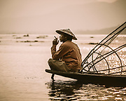 A moment of peace. A local Intha tribe fisherman relaxing on Lake Inle, Myanmar. Known for their unusual technique of leg-rowing whilst fishing in the shallow waters of this second largest lake in Myanmar, in the Shan HIlls - with an average depth in the dry season of only 7ft (2.1m)