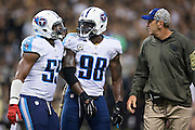 NEW ORLEANS, LA - NOVEMBER 8:  Head Coach Mike Mularkey and Wesley Woodyard #59 help Brian Orakpo #98 of the Tennessee Titans off the field after being called for a penalty during a game against the New Orleans Saints at Mercedes-Benz Superdome on November 8, 2015 in New Orleans, Louisiana.  The Titans defeated the Saints in overtime 34-28.  (Photo by Wesley Hitt/Getty Images) *** Local Caption *** Mike Mularkey; Wesley Woodyard; Brian Orakpo