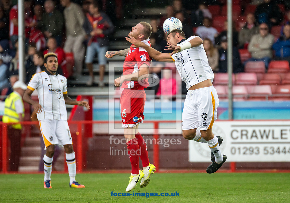 Mark Connolly of Crawley Town and Tom Pope of Port Vale challenge for the ball during the Sky Bet League 2 match at  Checkatrade.com Stadium, Crawley<br /> Picture by Liam McAvoy/Focus Images Ltd 07413 543156<br /> 05/08/2017