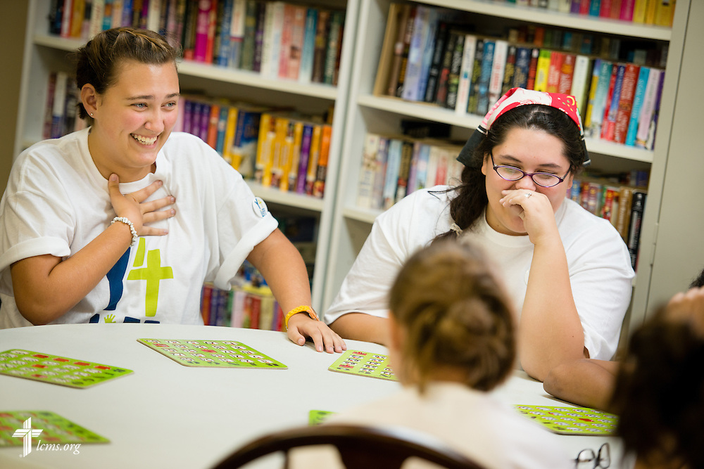 """Y4Life student volunteers Georgiana """"Maddie"""" McLoren and Andrea """"Andy"""" Stone share a lighthearted moment with other Y4Life student volunteers as they play bingo with elderly residents during a servant event on Saturday, Sept. 12, 2015, in Sanford, Fla. LCMS Communications/Erik M. Lunsford"""
