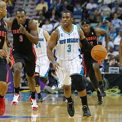 January 17, 2011; New Orleans, LA, USA; New Orleans Hornets point guard Chris Paul (3) drives down the court against the Toronto Raptors during the first quarter at the New Orleans Arena.   Mandatory Credit: Derick E. Hingle