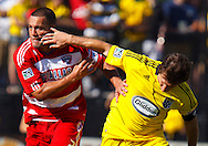 28 AUGUST 2010:  FC Dallas' Daniel Hernandez (2) get a handful from Guillermo Barros Schelotto of the Columbus Crew (7) during MLS soccer game between FC Dallas vs Columbus Crew at Crew Stadium in Columbus, Ohio on August 28, 2010.