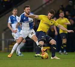 Matt Taylor of Bristol Rovers puts pressure on Johnny Mullins of Oxford United - Mandatory byline: Alex James/JMP - 17/01/2016 - FOOTBALL - The Kassam Stadium - Oxford, England - Oxford United v Bristol Rovers - Sky Bet League Two