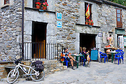Pilgrims at hotel on the Camiino de Santiago pilgrim route at Triacastela in Galicia, Spain