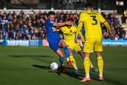 AFC Wimbledon defender Luke O'Neill (2) battles for possession with Fleetwood Town attacker Wes Burns (7) during the EFL Sky Bet League 1 match between AFC Wimbledon and Fleetwood Town at the Cherry Red Records Stadium, Kingston, England on 8 February 2020.
