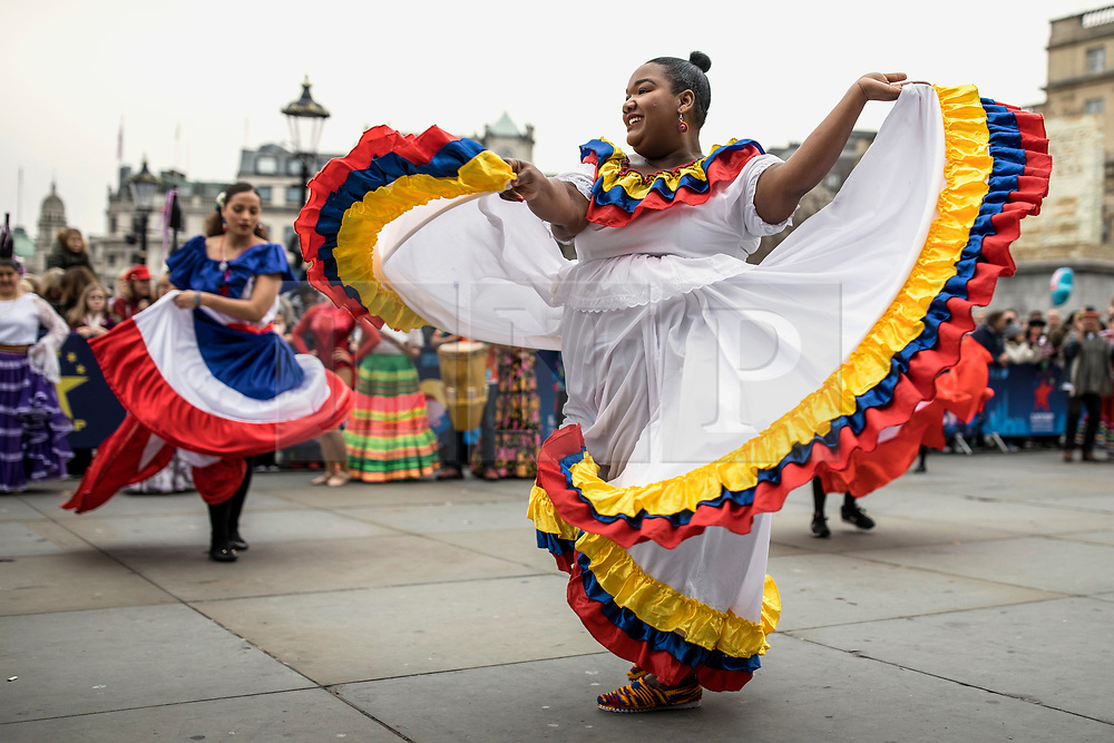 © Licensed to London News Pictures. 30/12/2018. London, UK. A dancer from Carnaval Del Pueblo, a dance group from across Latin America, performs at a preview ahead of the London New Year's Day Parade in Trafalgar Square. More than 8,000 performers from 26 countries will take part in the parade on 1st January 2019. Photo credit: Rob Pinney/LNP