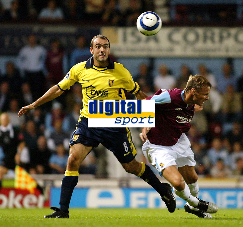 Photo: Chris Ratcliffe.<br />West Ham Utd v Aston Villa. The Barclays Premiership. 12/09/2005.<br />Gavin McCann barges Teddy Sheringham out of the way to this ball
