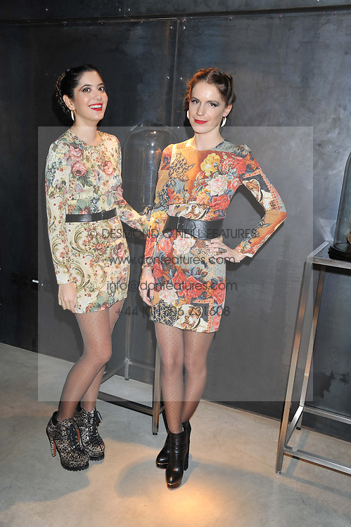 Left to right, NOOR FARES and EUGENIE NIARCHOS at a private view of jewellery by Eugenie Nairchos and Noor Fares entitled Galactic Garden held at Shizaru Mayfair, 112 Mount Street, London on 5th December 2012.