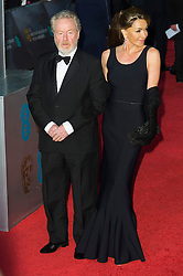 © Licensed to London News Pictures. 14/02/2016. London, UK. RIDLEY SCOTT and FELICITY HAYWOOD arrive on the red carpet at the EE British Academy Film Awards 2016 Photo credit: Ray Tang/LNP