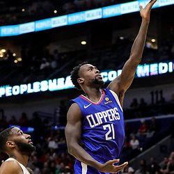 Oct 23, 2018; New Orleans, LA, USA; Los Angeles Clippers guard Patrick Beverley (21) shoots over New Orleans Pelicans guard Ian Clark (2) during the second quarter at the Smoothie King Center. Mandatory Credit: Derick E. Hingle-USA TODAY Sports