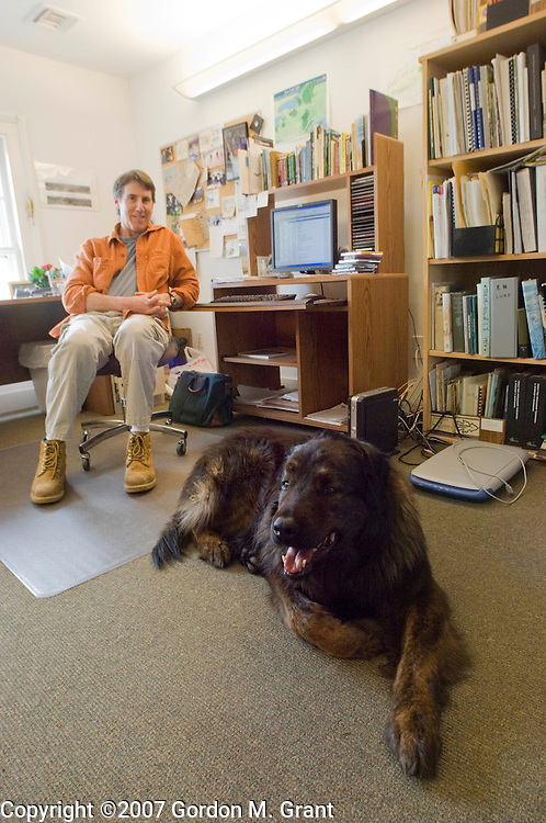 East Hampton, NY - 3/27/07 - Bruce Horwith, Natural Resources Manager at The Nature Conservancy in East Hampton, NY March 27, 2007, with his dog Simba. The Nature Conservancy allows its employees to bring their dogs to work with them.     (Photo by Gordon M. Grant)