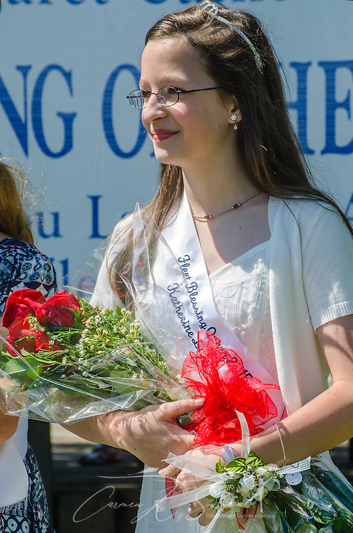 Fleet Blessing Queen Katherine Landry smiles as she receives a bouquet of roses at the 66th annual Blessing of the Fleet in Bayou La Batre, Alabama, May 3, 2015. The first fleet blessing was held by St. Margaret's Catholic Church in 1949, carrying on a long European tradition of asking God's favor for a bountiful seafood harvest and protection from the perils of the sea. The highlight of the event is a blessing of the boats by the local Catholic archbishop and the tossing of a ceremonial wreath in memory of those who have lost their lives at sea. The event also includes a land parade and a parade of decorated boats that slowly cruise through the bayou. (Photo by Carmen K. Sisson/Cloudybright)