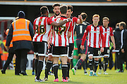 Brentford attacker, Sergi Canos (47) and other players celebrating after win during the Sky Bet Championship match between Brentford and Fulham at Griffin Park, London, England on 30 April 2016. Photo by Matthew Redman.