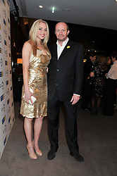NOELLE RENO and SCOT YOUNG at the launch of Samsung's NX Smart Camera at charity auction with David Bailey in aid of Marie Curie Cancer Care at the Bulgari Hotel, 171 Knightsbridge, London on 14th May 2013.