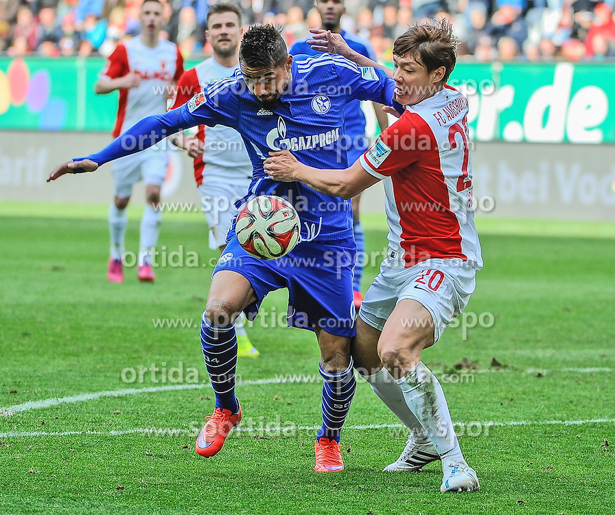 05.04.2015, SGL Arena, Augsburg, GER, 1. FBL, FC Augsburg vs Schalke 04, 27. Runde, im Bild im Zweikampf, Aktion, mit von links Kevin-Prince Boateng (Schalke 04) 9gegen Jeong-Ho Hong ( FC Augsburg ) 20 // during the German Bundesliga 27th round match between FC Augsburg and Schalke 04 at the SGL Arena in Augsburg, Germany on 2015/04/05. EXPA Pictures &copy; 2015, PhotoCredit: EXPA/ Eibner-Pressefoto/ Schreyer<br /> <br /> *****ATTENTION - OUT of GER*****