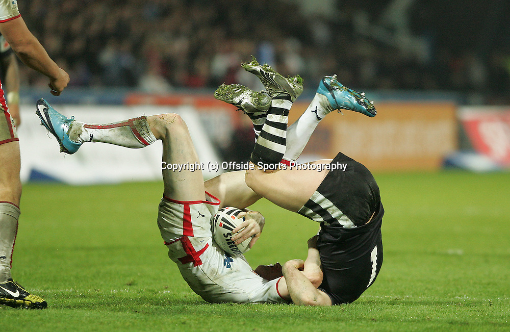 07/11/2009 Four Nations International Rugby League - England v New Zealand.<br />England's Sam Tomkins rolls on the ground with New Zealand's Lance Hohaia.<br />Photo: Matt Roberts/Offside