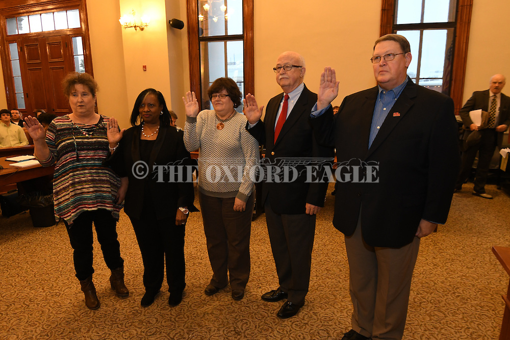 Election commissioners, from left, Faye Phillips, Lola Pearson, Debbie Black, Max Hipp, and Jim Stephens take the oath of office at the beginning of the court session, at the Lafayette County Courthouse in Oxford, Miss. on Tuesday, January 3, 2017.