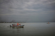 Two boats bring papier-mâché statues of Ganesh for the Ganesh Chaturthi Festival where the statues will be dumped into the sea to symbolically return to nature.