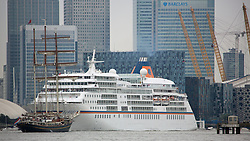 © Licensed to London News Pictures. 07/09/2014. Gulden Leeuw passing cruise ship Europa. The biggest tall ships event in London for 25 years is continuing across this weekend. Visitors took the opportunity to sail in tall ships up and down the Thames and go onboard those moored at Greenwich and Woolwich. The Royal Greenwich Tall Ships Festival concludes on Tuesday when all 50 vessels will sail down river together. Credit : Rob Powell/LNP